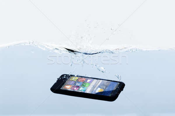 Mobile Phone Submerged In Water Stock photo © AndreyPopov