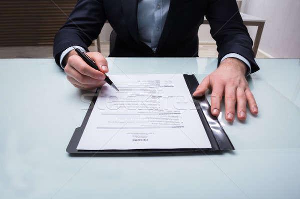 Businessman Analyzing Resume Stock photo © AndreyPopov