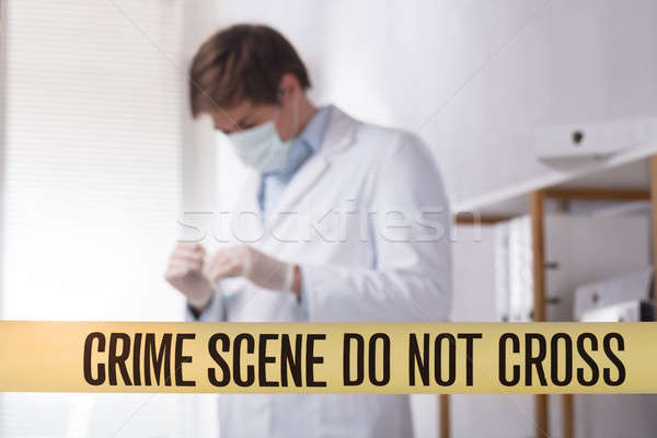 Close-up Of Crime Scene Do Not Cross Tape Stock photo © AndreyPopov