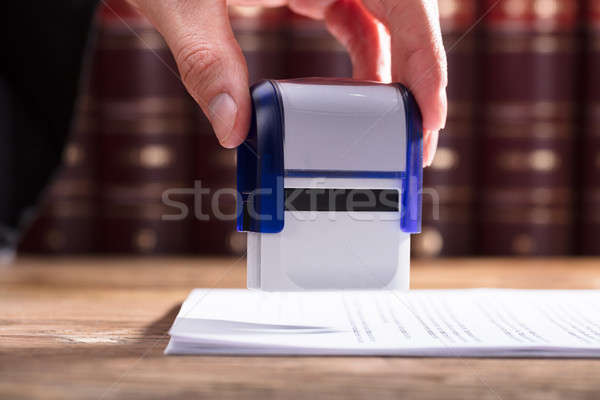 Judge Stamping Document Stock photo © AndreyPopov