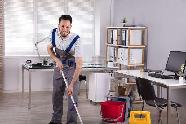 Mosolyog férfi gondnok takarítás padló portré Stock fotó © AndreyPopov