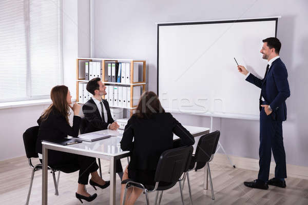 Stock photo: Businessman Giving Presentation To His Colleague