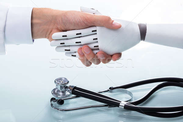 Doctor And Robot Shaking Hands Stock photo © AndreyPopov