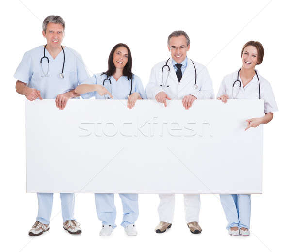 Group Of Doctor Holding Placard Stock photo © AndreyPopov