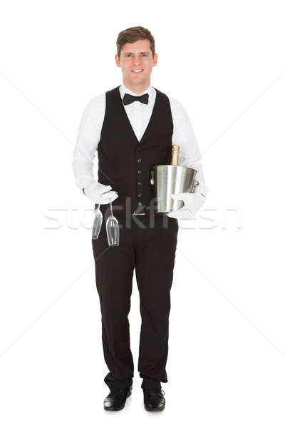Waiter Holding A Wine Cooler And Champagne Glass Stock photo © AndreyPopov