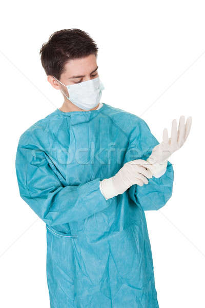 Surgeon putting on surgical gloves Stock photo © AndreyPopov