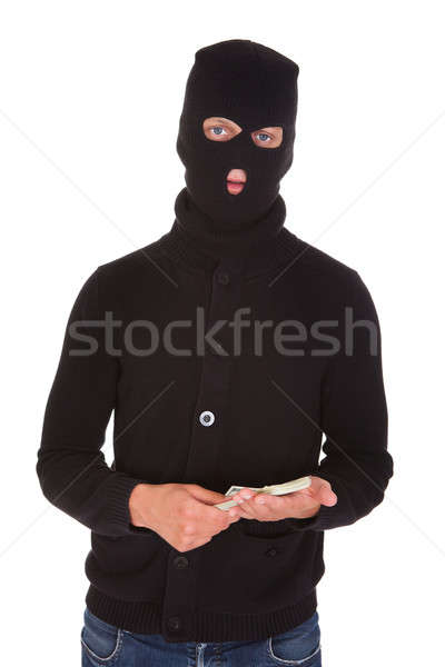Burglar Holding Money Stock photo © AndreyPopov