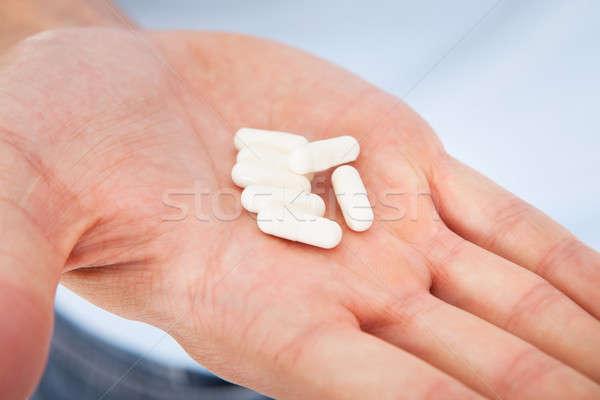 Hand Holding Medicines Stock photo © AndreyPopov