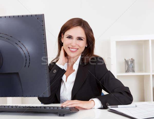 Businesswoman Using Computer Stock photo © AndreyPopov