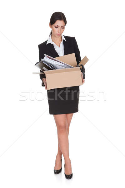 Young Business Woman Holding A Box Of Documents Stock photo © AndreyPopov