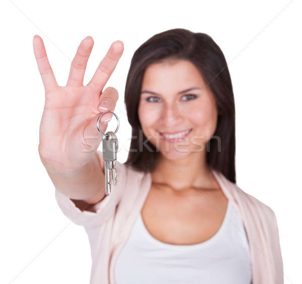 Smiling woman with a set of keys Stock photo © AndreyPopov