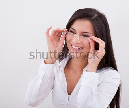 Boldog nő visel olvasószemüveg kezek kiemelt Stock fotó © AndreyPopov