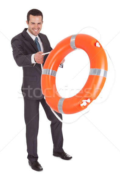 Young businessman with life buoy Stock photo © AndreyPopov