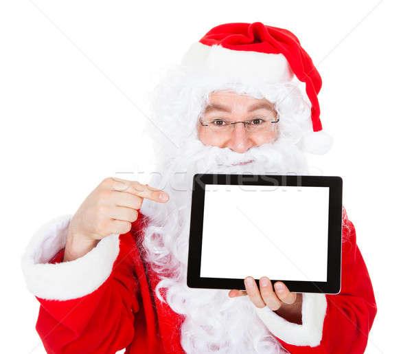 Portrait of santa pointing at digital tablet Stock photo © AndreyPopov