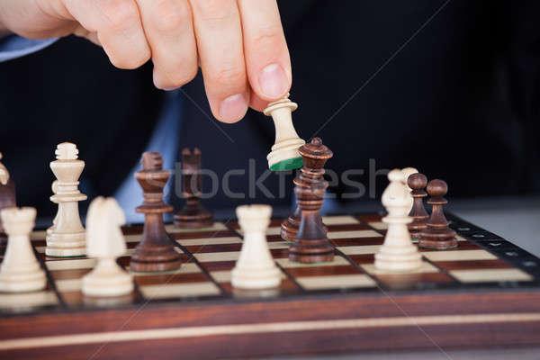 Menselijke hand spelen schaken business hand Stockfoto © AndreyPopov