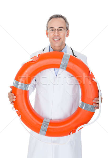 Happy Male Doctor Holding Rescue Ring Stock photo © AndreyPopov