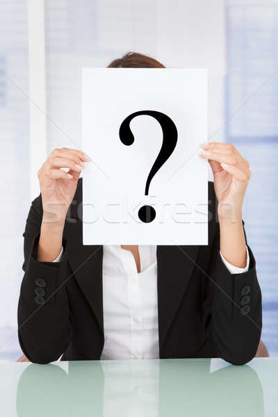 Businesswoman Holding Paper With Question Mark In Front Of Face Stock photo © AndreyPopov