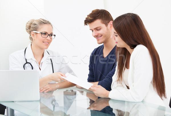 врач рецепт бумаги пару женщины столе Сток-фото © AndreyPopov