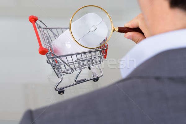 Businessman inspecting shopping cart Stock photo © AndreyPopov