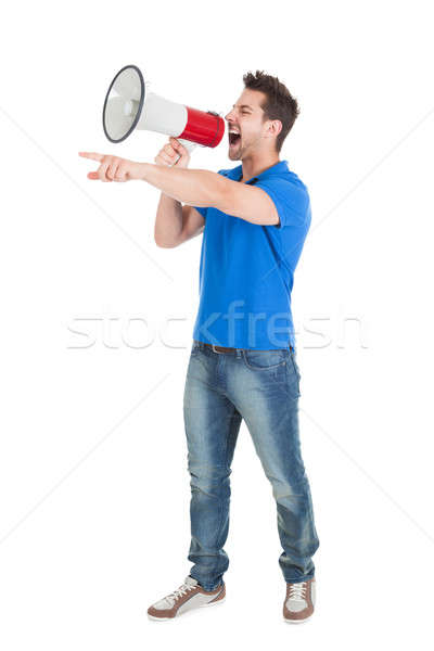 Man Screaming Into Bullhorn While Pointing Away Stock photo © AndreyPopov
