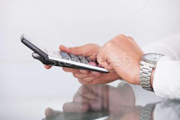 Businessman's Hands Using Calculator Stock photo © AndreyPopov