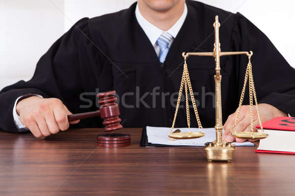 Judge With Mallet And Weight Scale In Courtroom Stock photo © AndreyPopov