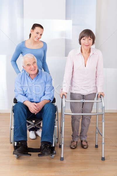 Mozgássérült idős pár gondozó portré női öregek otthona Stock fotó © AndreyPopov