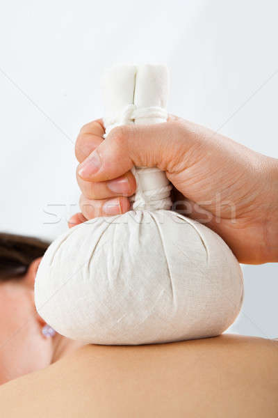 Woman Receiving Massage With Herbal Compress Bags At Spa Stock photo © AndreyPopov