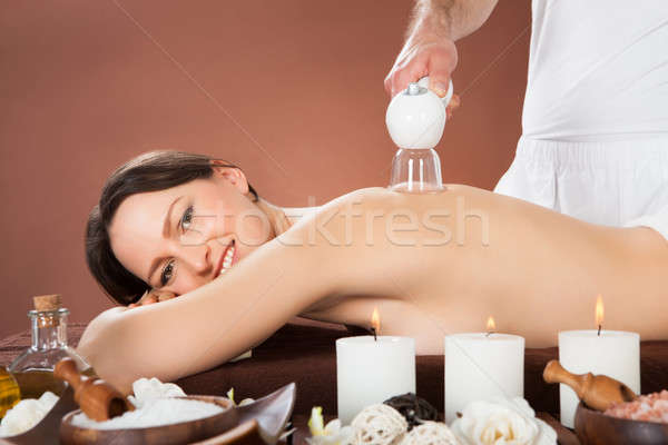Woman Receiving Cupping Massage At Spa Stock photo © AndreyPopov