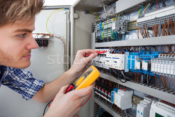 Stock photo: Technician Examining Fusebox With Insulation Resistance Tester
