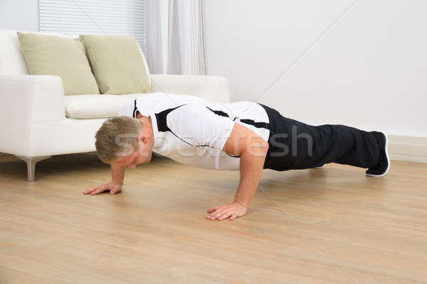 Muscular Man Doing Pushups Stock photo © AndreyPopov