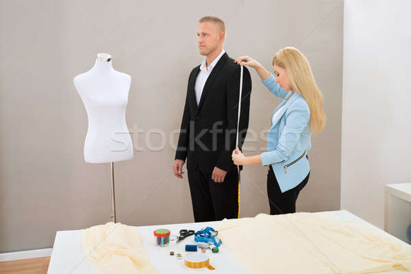Female Tailor Taking Measurement Of Suit Stock photo © AndreyPopov