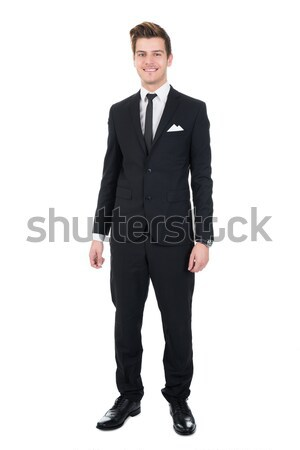 Portrait Of Confident Businessman With Hands On Hips Stock photo © AndreyPopov