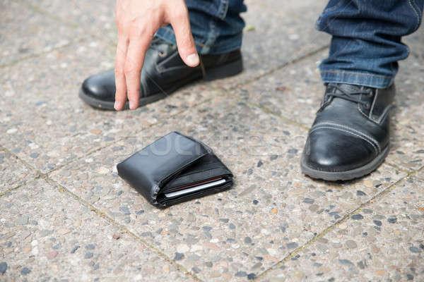 Man Picking Up Fallen Wallet Stock photo © AndreyPopov
