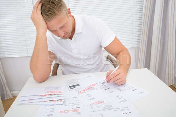 Worried Man Calculating Bills Stock photo © AndreyPopov