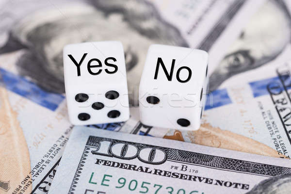 Yes And No Dices On Dollar Bills Stock photo © AndreyPopov