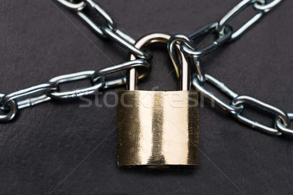 Closeup Of Metallic Padlock And Chains Stock photo © AndreyPopov