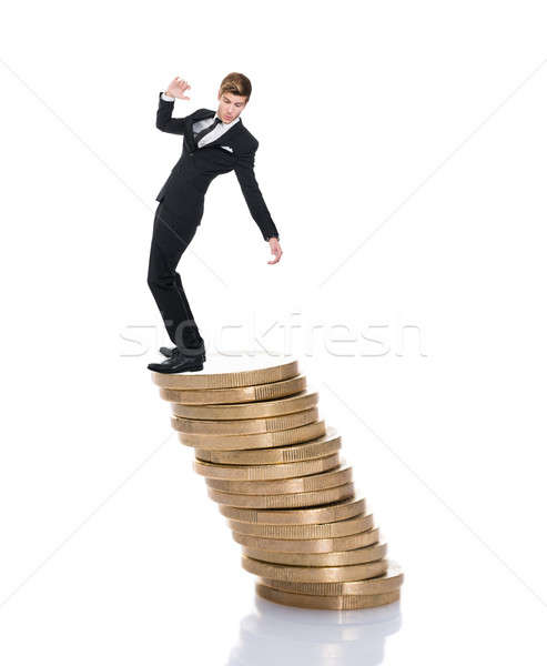 Businessman Balancing On Stacked Coins Stock photo © AndreyPopov