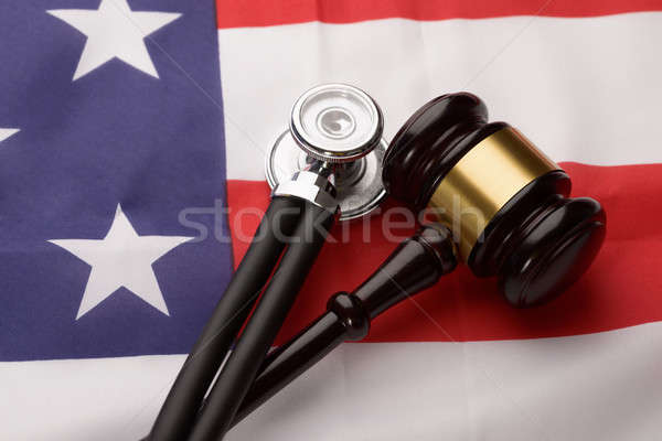 Wooden Gavel And Stethoscope On Usa Flag Stock photo © AndreyPopov