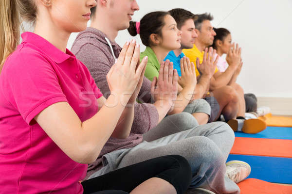 Multiethnic Group Of People Doing Meditation Stock photo © AndreyPopov