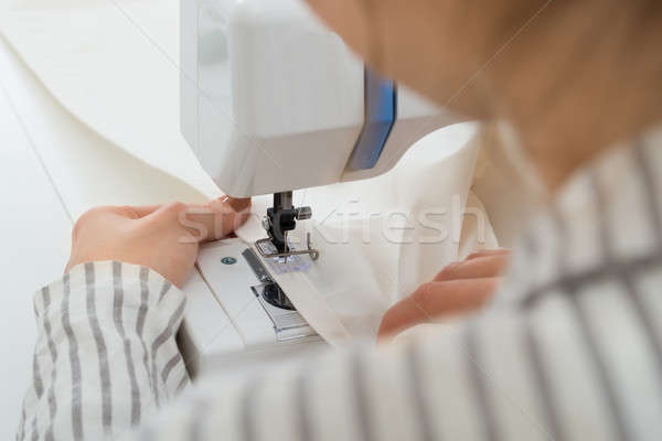 Close-up On Woman Stitching Fabric Stock photo © AndreyPopov