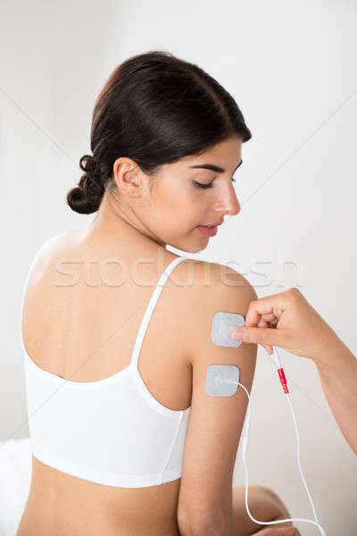 Woman Getting Electrodes Therapy On Hand Stock photo © AndreyPopov