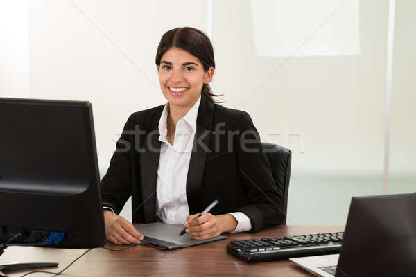 Female Designer With Graphic Tablet At Desk Stock photo © AndreyPopov