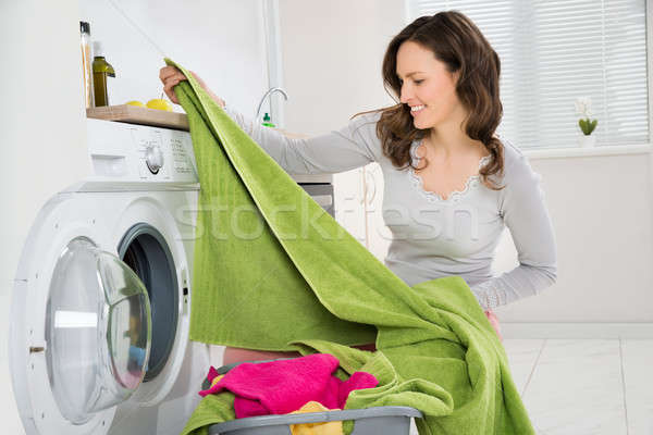 Woman Laundering Clothes In Washer Stock photo © AndreyPopov