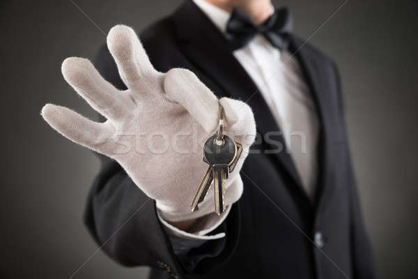 Close-up Of Waiter Holding Keys Stock photo © AndreyPopov