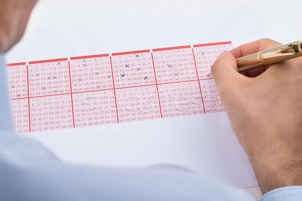 Businessperson Marking On Lottery Ticket Stock photo © AndreyPopov