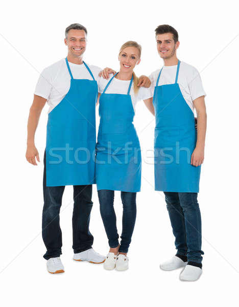 Janitors Wearing Blue Apron Stock photo © AndreyPopov