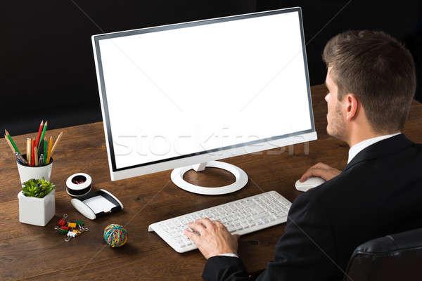 üzletember dolgozik asztali számítógép fiatal fából készült asztal Stock fotó © AndreyPopov