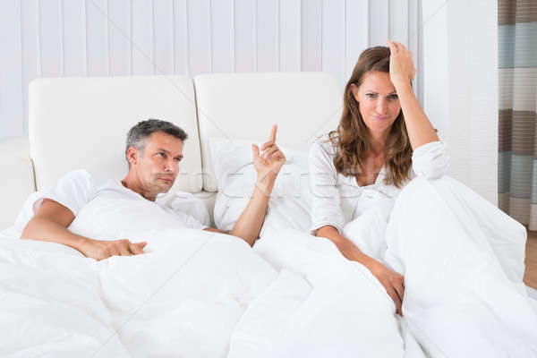 Couple Arguing In The Bedroom Stock photo © AndreyPopov