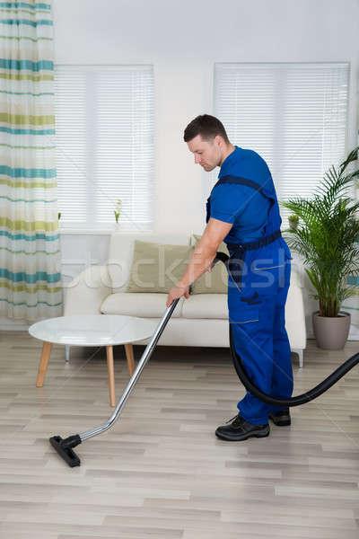 Lavoratore pulizia piano aspirapolvere vista laterale Foto d'archivio © AndreyPopov